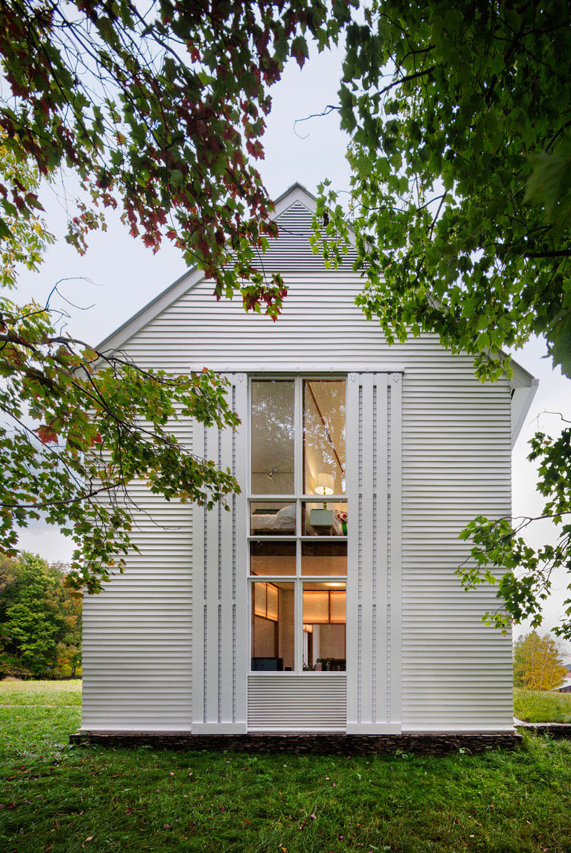 A modern farmhouse in pennsylvania with rolling sunshades for Modern farmhouse windows